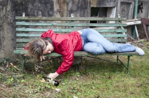 drunk woman sleeping on the bench